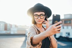 Pretty cute woman makes selfie sunset stock photos