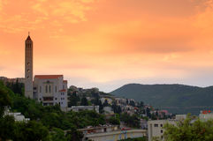Beautiful Adriatic coast view. New christian church in Neum town on blazing sky background at dawn.Neum is Bosnia and Herzegovina's only town located on the Stock Images