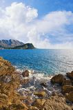 Beautiful Adriatic Sea landscape. Montenegro, view of stone coast and Sveti Nikola island near Budva city Royalty Free Stock Photo