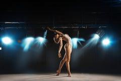Beautiful adult ballerina on stage posing Stock Photos