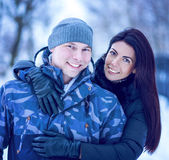 Beautiful adult couple love, park in winter Royalty Free Stock Photo