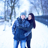 Beautiful adult couple love, park in winter Stock Photography