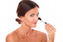 Beautiful adult female cleaning her face Stock Image