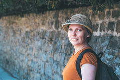 Beautiful adult female with straw hat posing on mediterranean st Royalty Free Stock Images