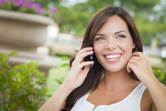 Beautiful Adult Female Talking on Cell Phone Outdoors on Bench Stock Images