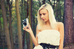 Beautiful adult girl with retro photo camera Stock Images