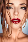 Beautiful adult girl with wet hair looking at camera Royalty Free Stock Photo