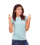 Beautiful adult lady crossing her fingers Royalty Free Stock Photo