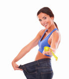 Beautiful adult lady giving to you measuring tape Royalty Free Stock Image