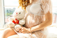 Beautiful adult pregnant woman. Waiting for the baby. Pregnancy. Care, tenderness, motherhood, childbirth. Beautiful adult pregnant woman. Waiting for the baby Stock Photos