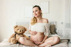 Beautiful adult pregnant woman. Waiting for the baby. Pregnancy. Care, tenderness, motherhood, childbirth. Stock Image