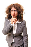 Beautiful adult secretary demanding silence Royalty Free Stock Photography