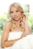 Beautiful adult sensuality woman. Portrait of beautiful young adult sensuality blonde woman wrapped in white fur Stock Photos