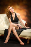 Beautiful adult sexy woman sitting on chair Stock Photography