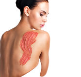 Beautiful adult woman cares about skin of body using cosmetic scrub Royalty Free Stock Image