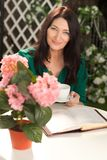Woman, a diary and a cup of tea Stock Image