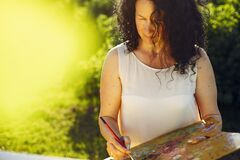 Free Beautiful Adult Woman Drawing In A Summer Field Stock Image - 216739801