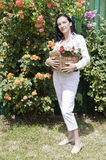 Beautiful adult woman in garden Royalty Free Stock Photography