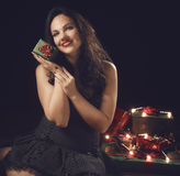 Beautiful adult woman and gift Royalty Free Stock Images