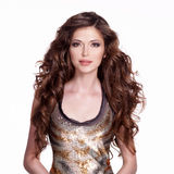 Beautiful adult woman with long brown curly hair. Royalty Free Stock Images