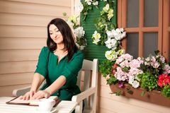 Woman reading a book on the veranda Stock Photo