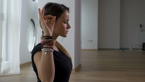 Beautiful adult woman meditating in a yoga practice. Beautiful adult woman meditating in yoga practice stock footage
