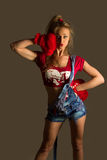 Beautiful adult woman with red fur boxing gloves Royalty Free Stock Photography
