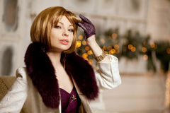 Beautiful adult woman in  winter coat with fur. Trendy modern bl Royalty Free Stock Photo