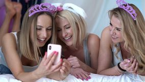 Beautiful adult women celbrating birthday and using smartphone. Footage of three beautiful adult women celbrating birthday and using smartphone stock footage