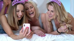 Beautiful adult women celbrating birthday and using smartphone. Footage of three beautiful adult women celbrating birthday and using smartphone stock video