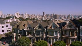 Beautiful aerial drone flight over cozy houses in San Francisco downtown district cityscape panorama. Aerial drone flight over cozy houses in San Francisco stock video