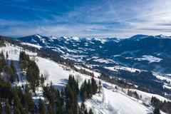Beautiful aerial drone panorama of mountain valley, cottages and villages royalty free stock photo