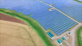 Beautiful aerial drone shot of futuristic modern urban green field ecology solar energy panel renewable power station. Fascinating aerial drone view on stock footage