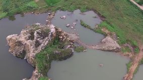 Beautiful Aerial/drone view of the ex-rock mining area in the slawi city indonesia stock video footage