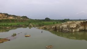 Beautiful Aerial/drone view of the ex-rock mining area in the slawi city indonesia stock footage