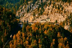 Beautiful aerial fall view of cable car ropeway funicular in austrian alps. Red cable railway car in the mountains stock images
