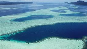Beautiful aerial footage of reef structure in Raja Ampat. The remote and healthy coral reefs found throughout Raja Ampat, Indonesia, are surrounded by calm seas stock video
