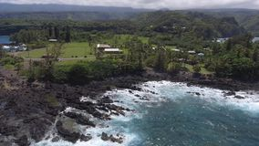 Beautiful aerial 4k drone seascape tropic nature of Maui island Keanae Hawaii Pacific ocean green beach shore coastline stock video footage