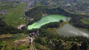 Aerial landscape of the Color Lake in Dieng stock video footage