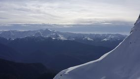 Beautiful aerial landscape winter mountain and snowy slopes on sky background. Beautiful aerial landscape winter mountain and snowy slopes on clear sky stock video