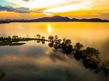 Sunset at Bang Pra reservoir. Beautiful aerial nature view of sunset over Bang Pra reservoir, Chonburi province, Thailand royalty free stock image