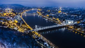 Beautiful aerial night shot about a big town with bridges. In winter time Royalty Free Stock Photography