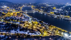 Beautiful aerial night shot about a big town with bridges. In winter time Royalty Free Stock Photo