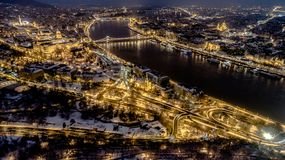Beautiful aerial night shot about a big town with bridges. In winter time Stock Photo