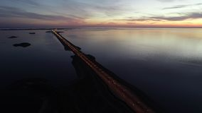 Beautiful aerial panorama of bridge and river in late evening in summer. stock video footage
