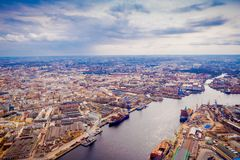 Beautiful aerial panoramic view of the Neva River with some ships in a port with surrounding of some buildings of the. City from a height, in the summer, St Stock Images