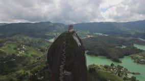 Backwards aerial drone view of La Piedra del Peñol in Colombia