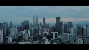 Aerial of morning view at Kuala Lumpur skyline with KLCC building stock video footage
