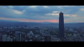 Aerial of sunrise at Kuala Lumpur skyline with the Tun Razak Exchange building stock video