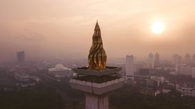 Beautiful aerial sunset view of National Monument. JAKARTA - Indonesia. May 21, 2018: Beautiful aerial sunset view of golden torch of National Monument in Stock Photos
